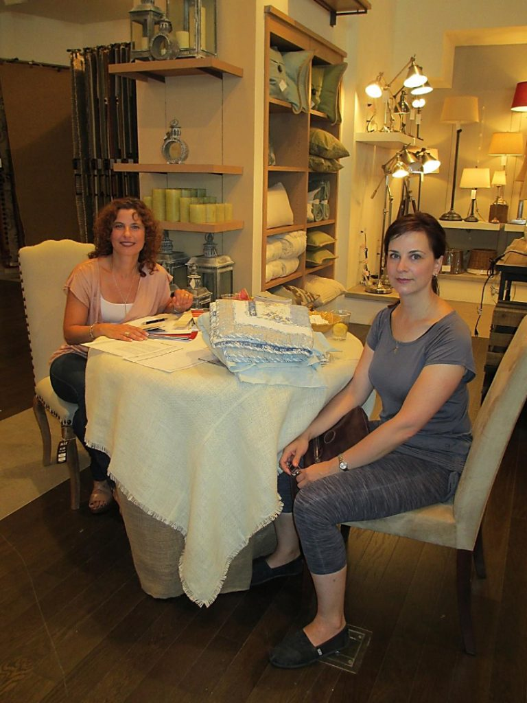 Dianne Amaral-Medeiros & others at Pottery Barn Design Studio Open Housesitting at table with other woman at Pottery Barn Design Studio Open House