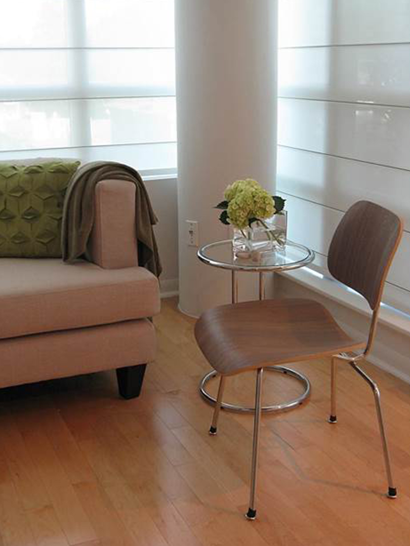 homefront redesigns project Islington Condo, chair in modern living room in Etobicoke, Toronto